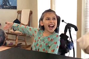 Happy young girl in wheelchair