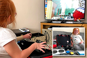 Young girl using adapted gaming setup