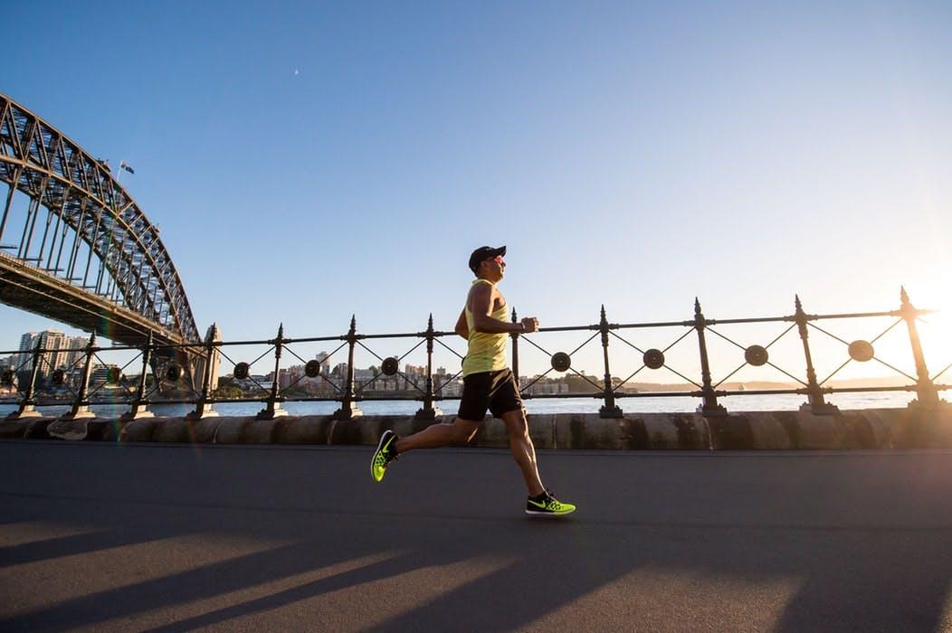 Man running on the bridge at daylight