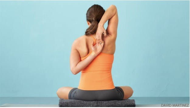 Hand clasped behind back yoga pose