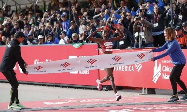 Brigid Kosgei crossing the marathon finish line