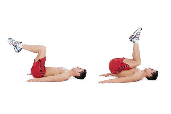 male performing lower reverse crunch