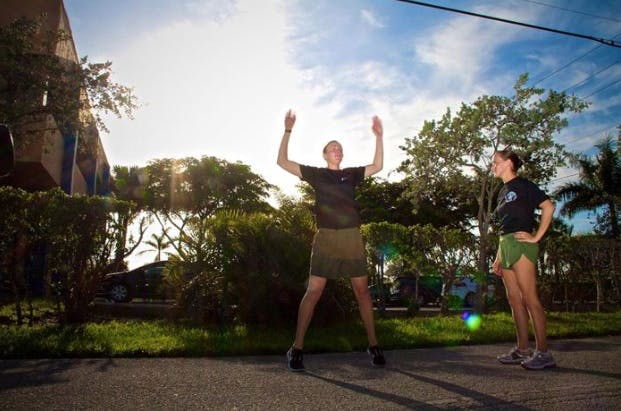 Marine getting better at running by doing jumping jacks
