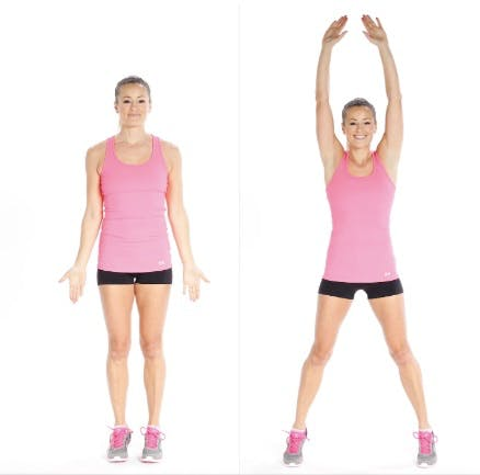 Woman doing jumping jacks as pre-stretch workout before running