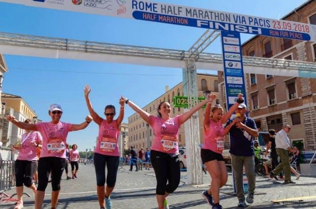 Marathon runners cheering up at the finish line