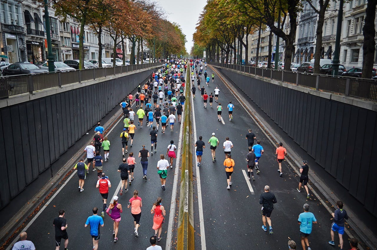 People running a marathon in the street