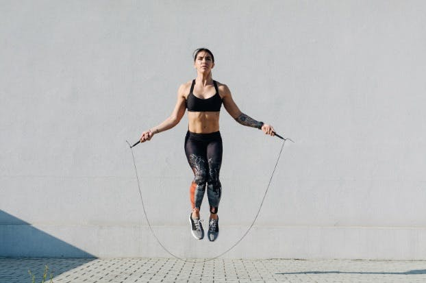 Woman jump roping as dynamic stretch before running