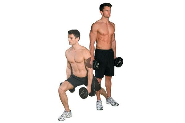 man performing transverse lunge with dumbbells