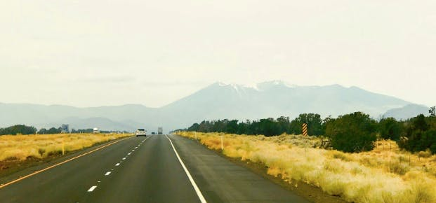 A road in Arizona, with mountains at the horizon.