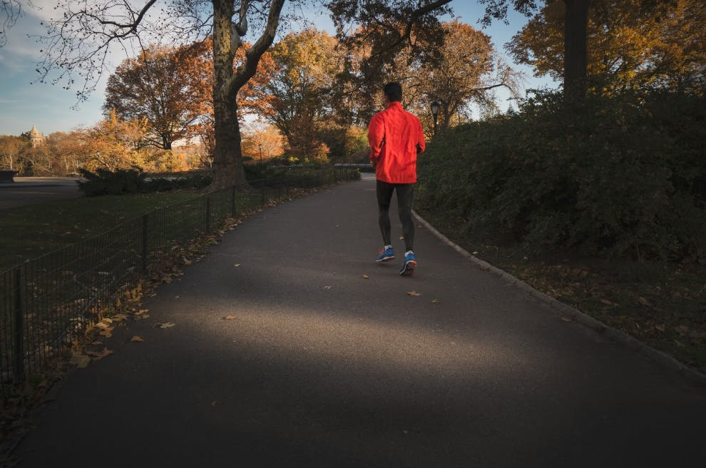 woman jogging during the fall