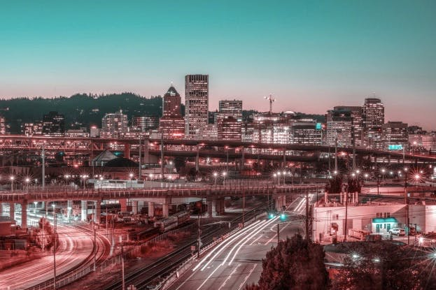 Portland, Oregon, at dusk, the city lights, winding roads and bridges.