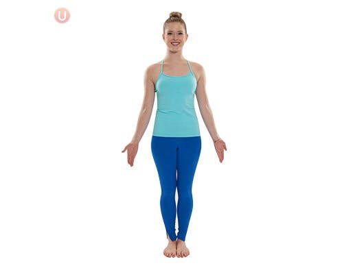 Woman doing the yoga mountain pose to relieve knee pain