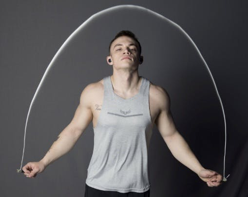 Fit man jumping rope to train his body for running