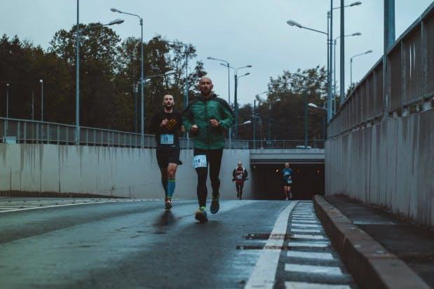 Men running a marathon in the city