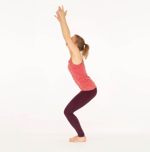 Woman doing the chair pose, a yoga position for bad knees