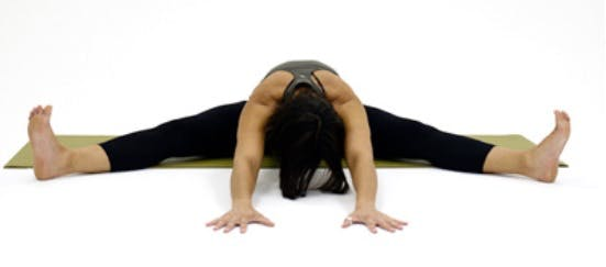Yoga pose called the wide-angle seated forward bend. used for knee pain