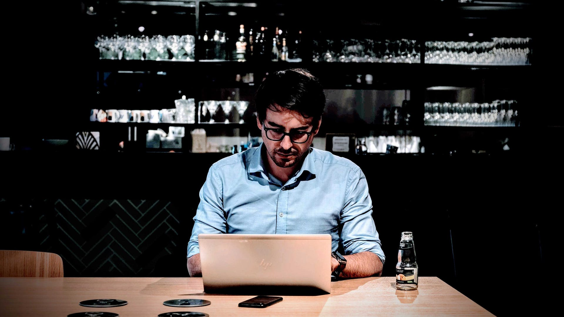 Man working on a laptop in a bar