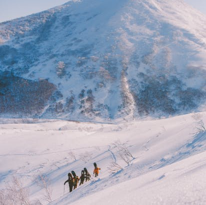 snowboarders backcountry hiking Niseko Japan