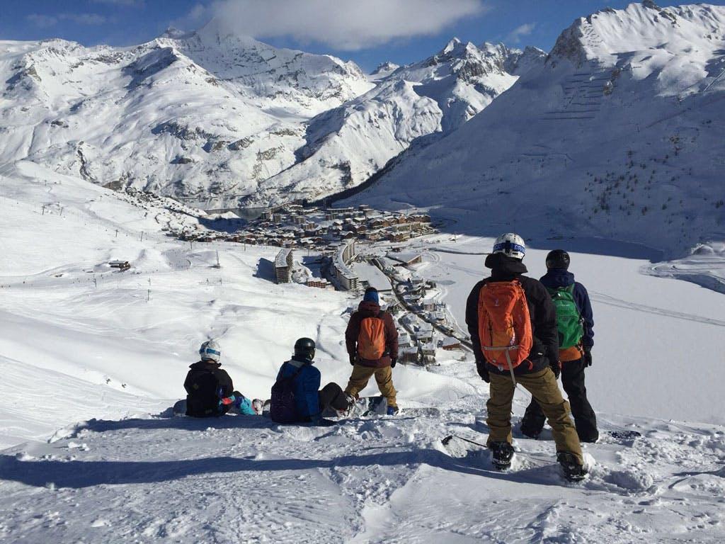 Freeride snowboarders enjoying view Tignes