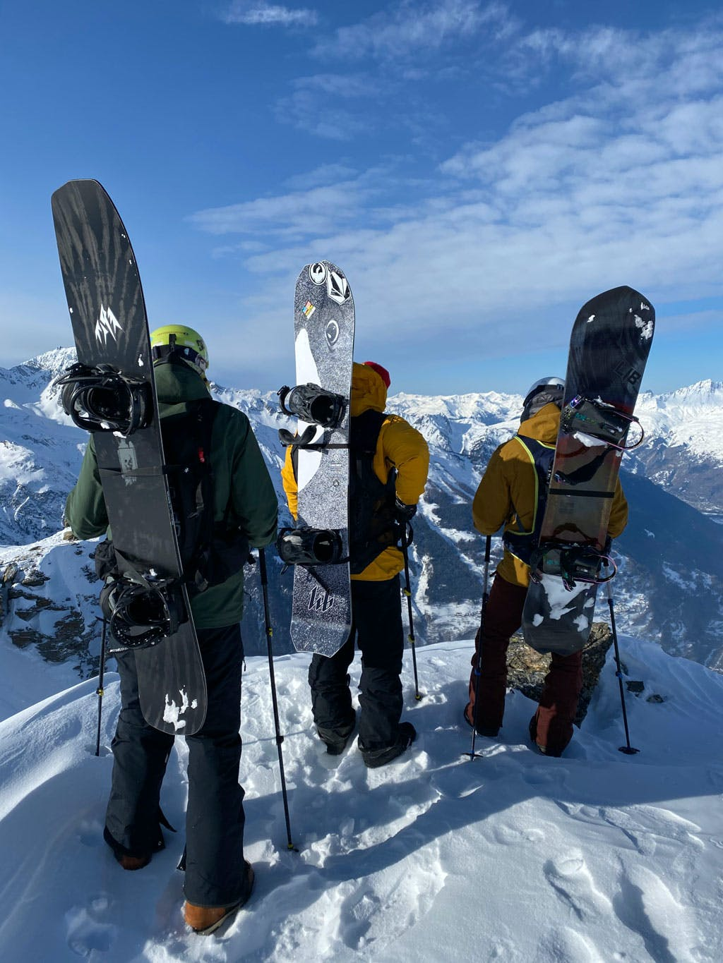 Backcountry Freeride snowboarders scoping lines