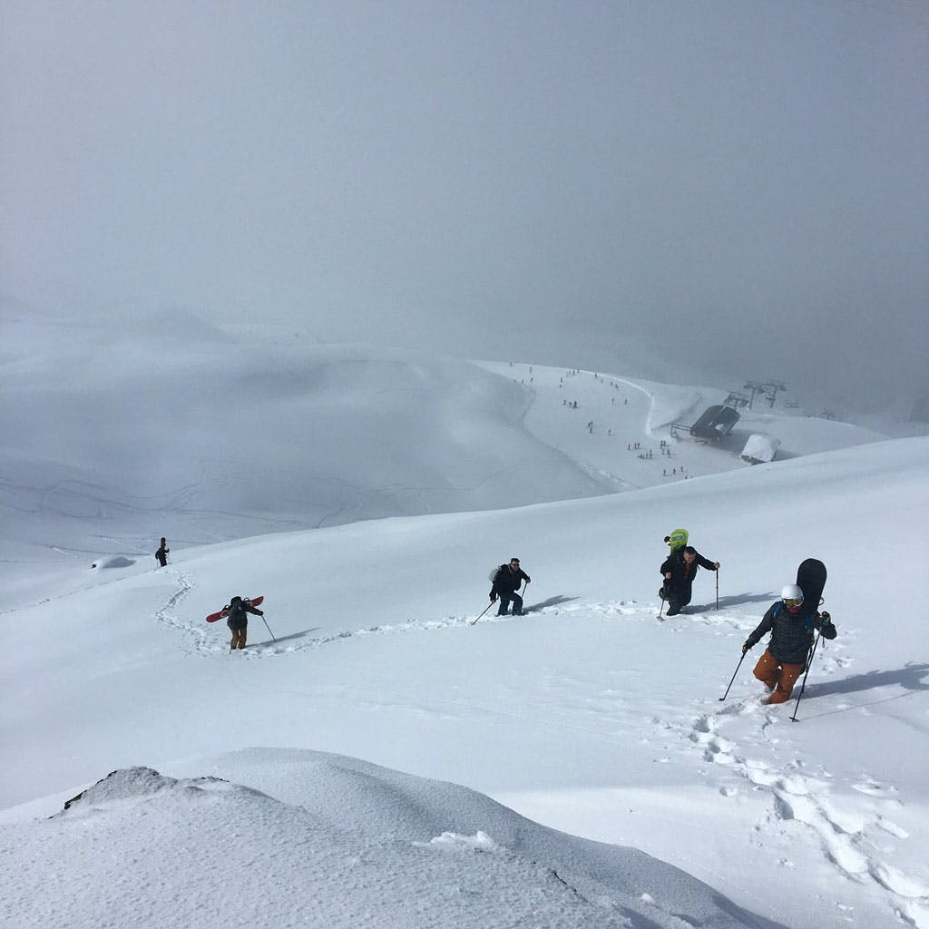 snowboarders hiking backcountry freeride