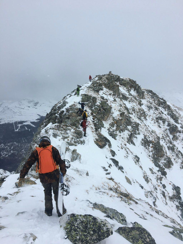 snowboarders Ridgeline hike to powder field