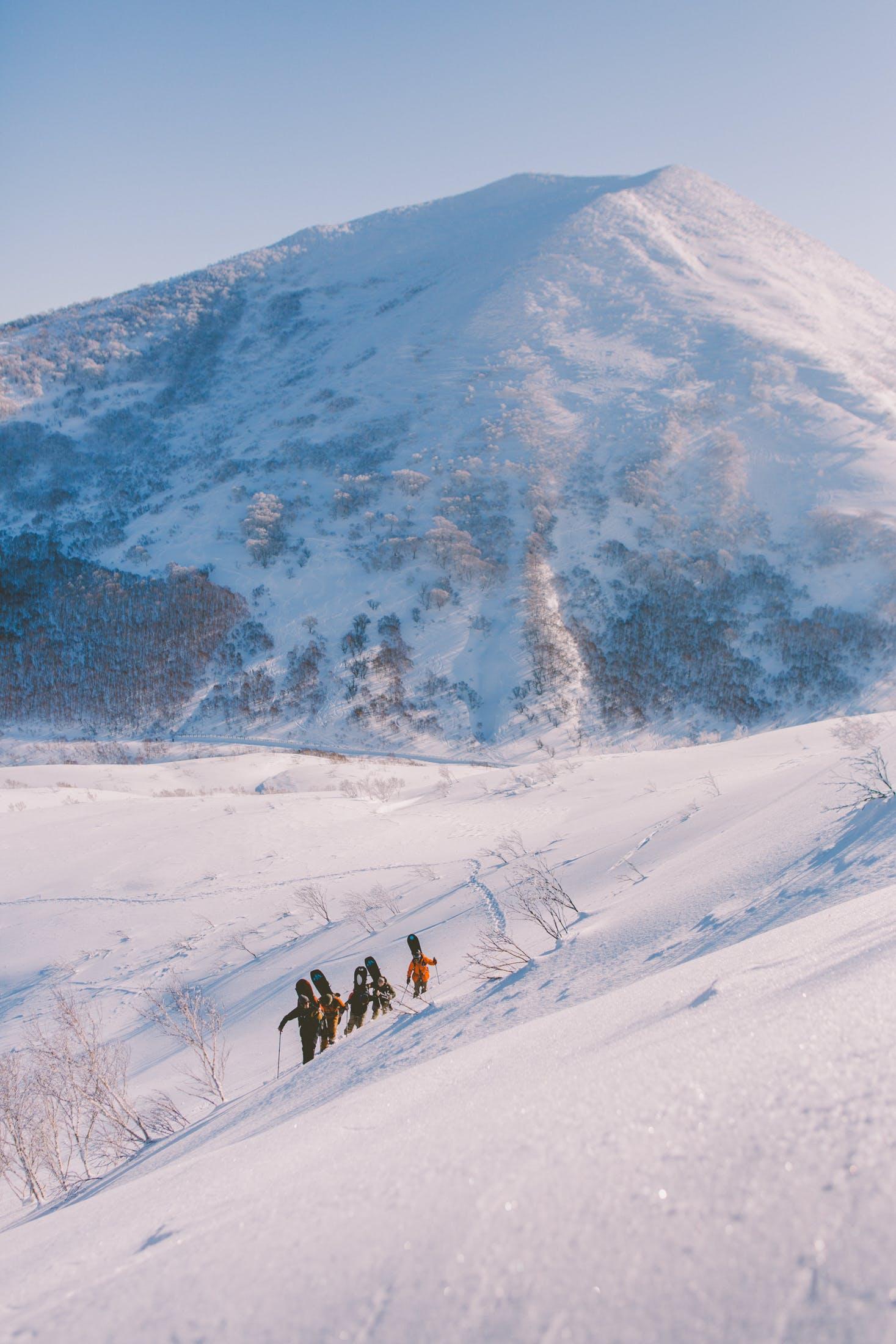 snowboarders backcountry hiking Niseko Japan