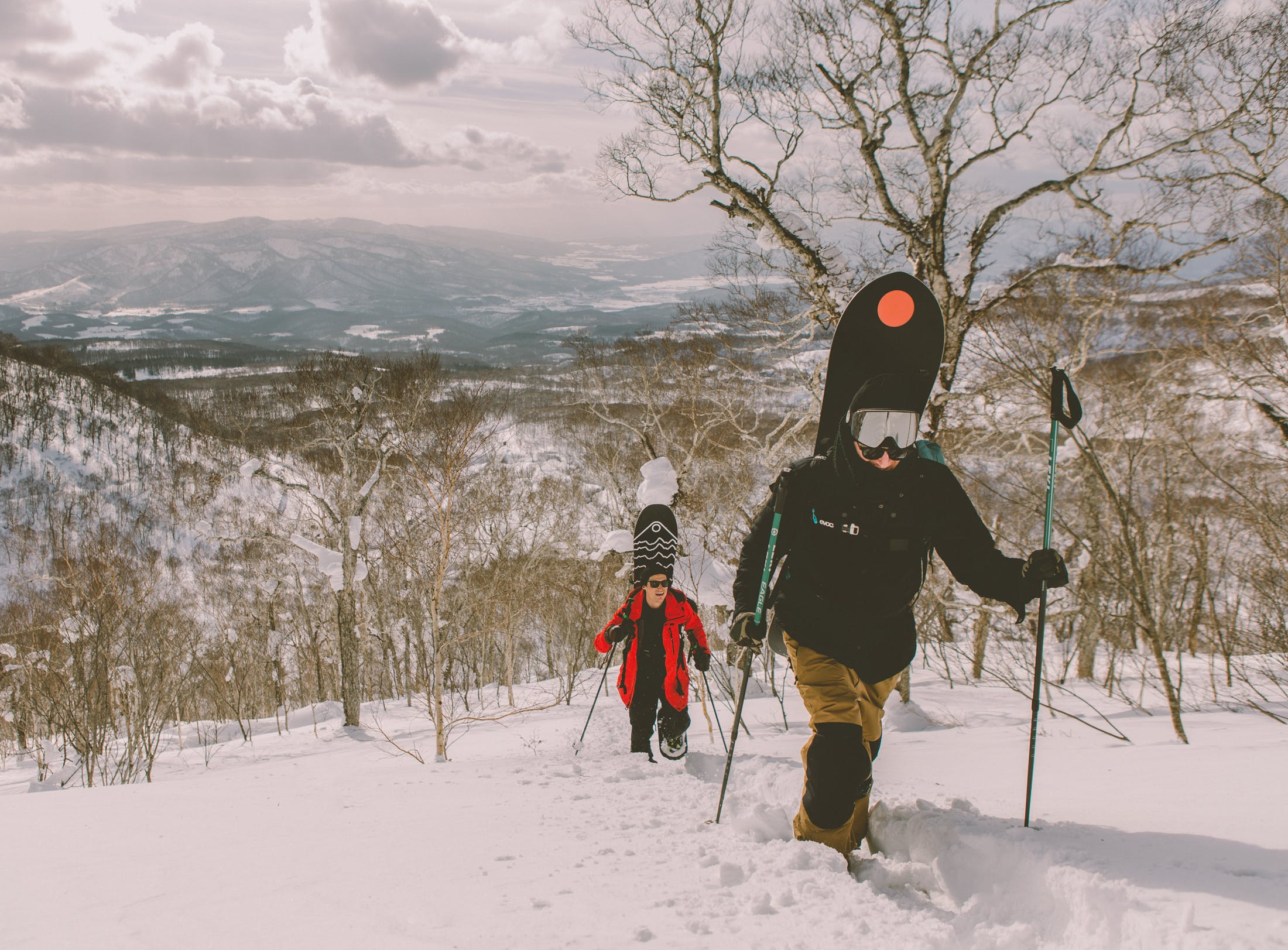 snowboarders backcountry hiking Japan