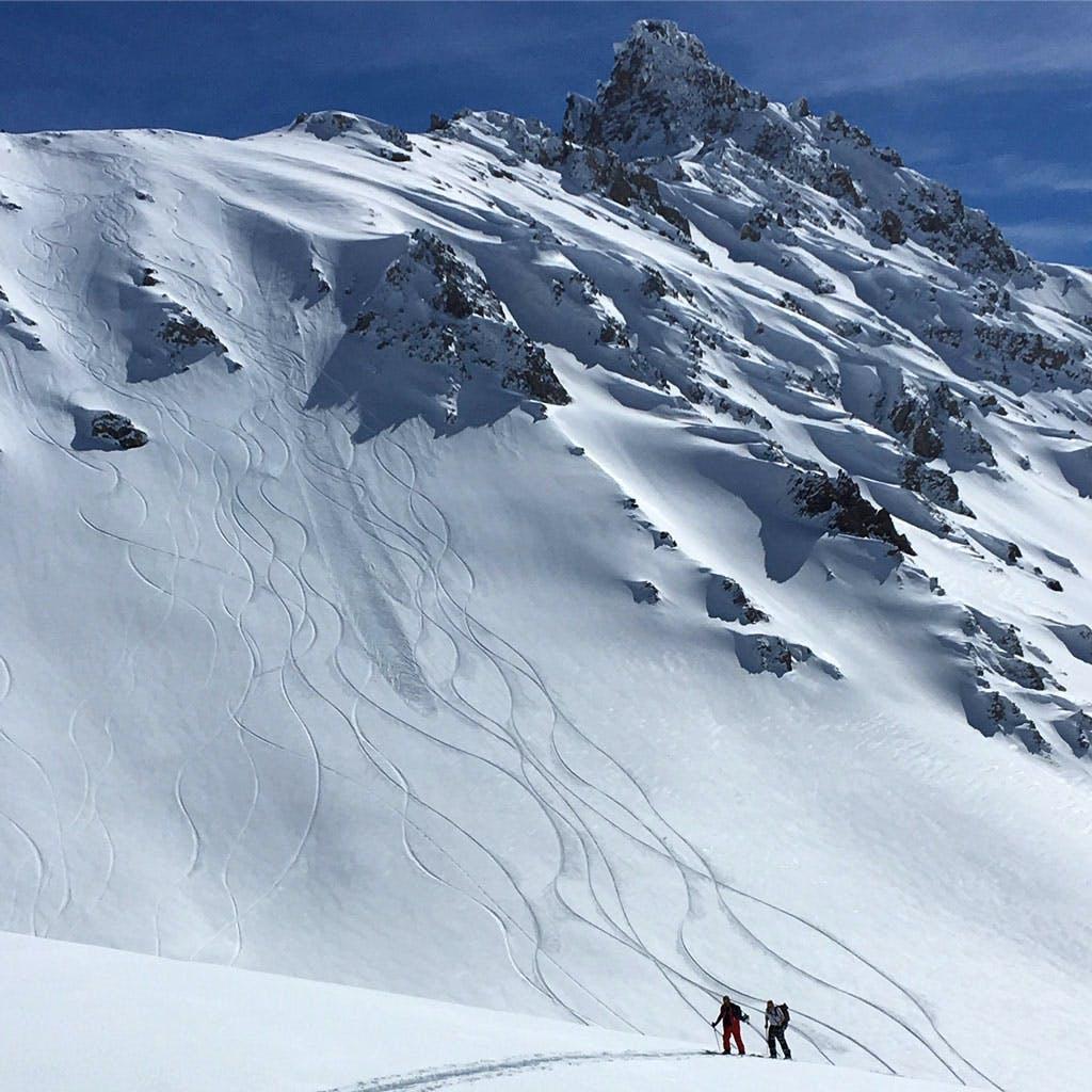 Splitboarders hiking Tignes