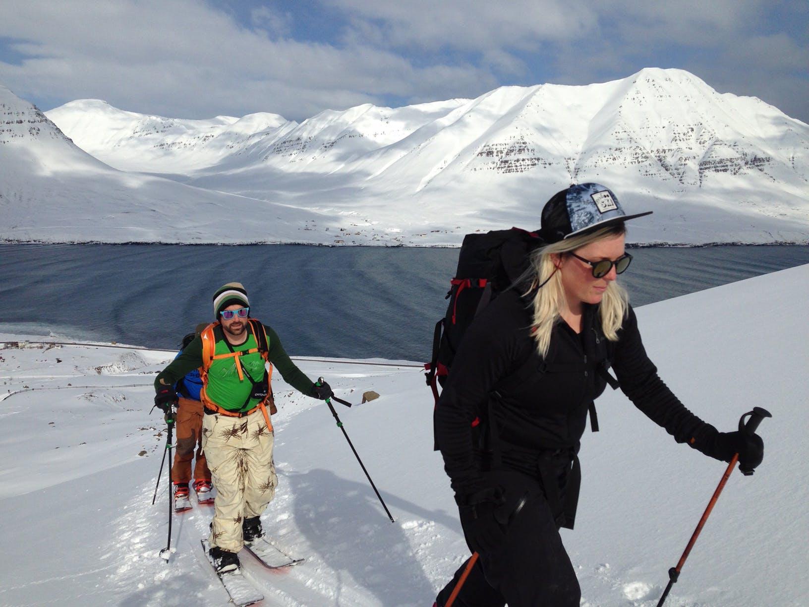 Splitboarders hiking fjords Iceland