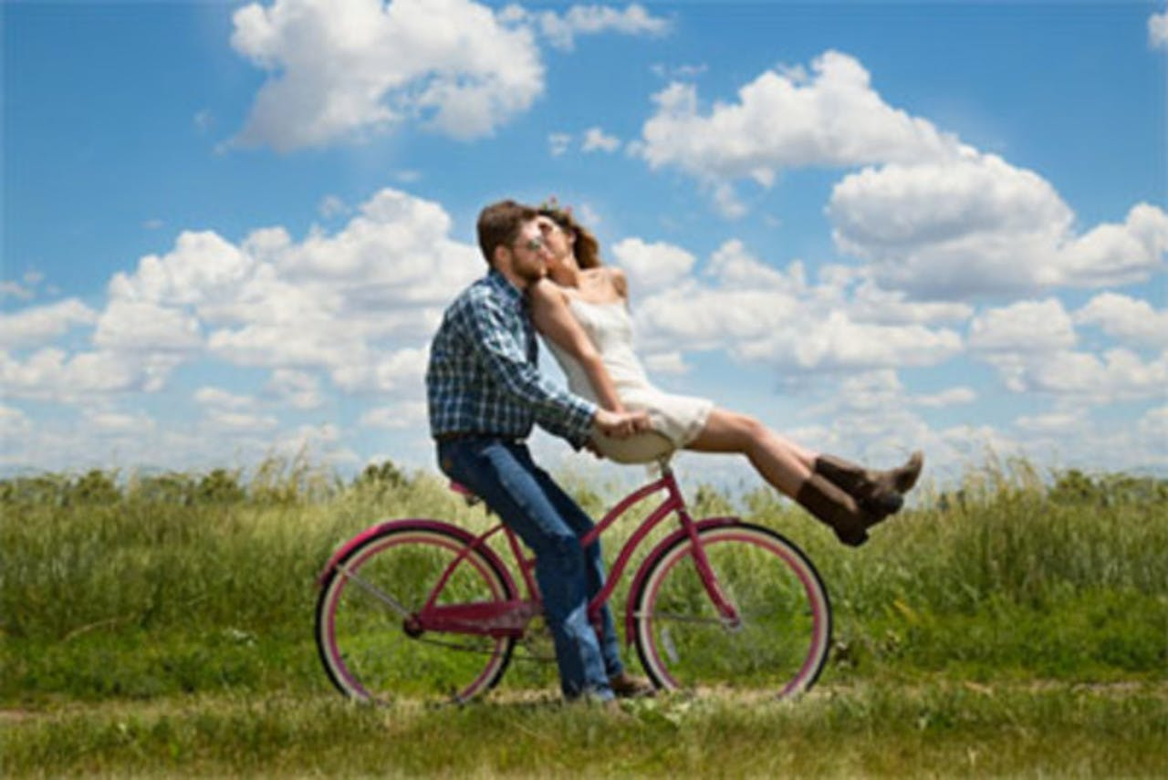 Boy and a girl on a bicycle