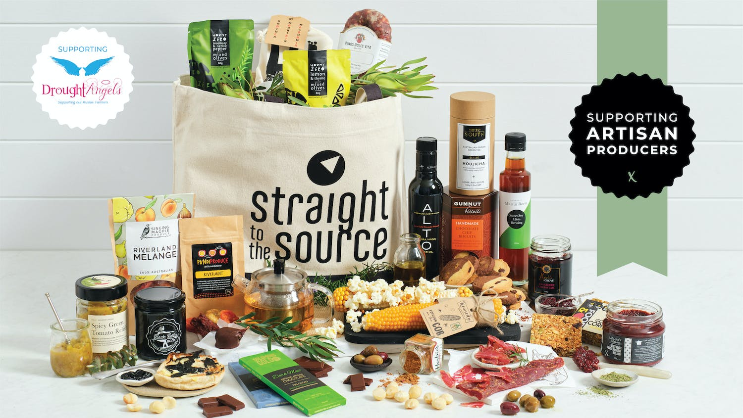 A Straight To The Source market bag filled & overflowing with artisan food products to create a gift bag we're calling Christmas 'In The Bag'