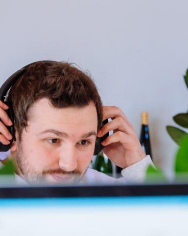 Image of Bart sitting behind a desk