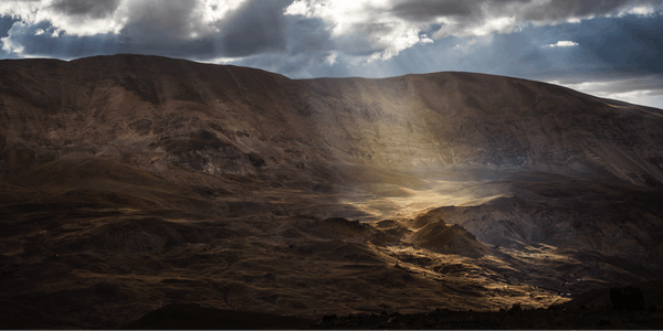 Rolling mountain hills with light shaft