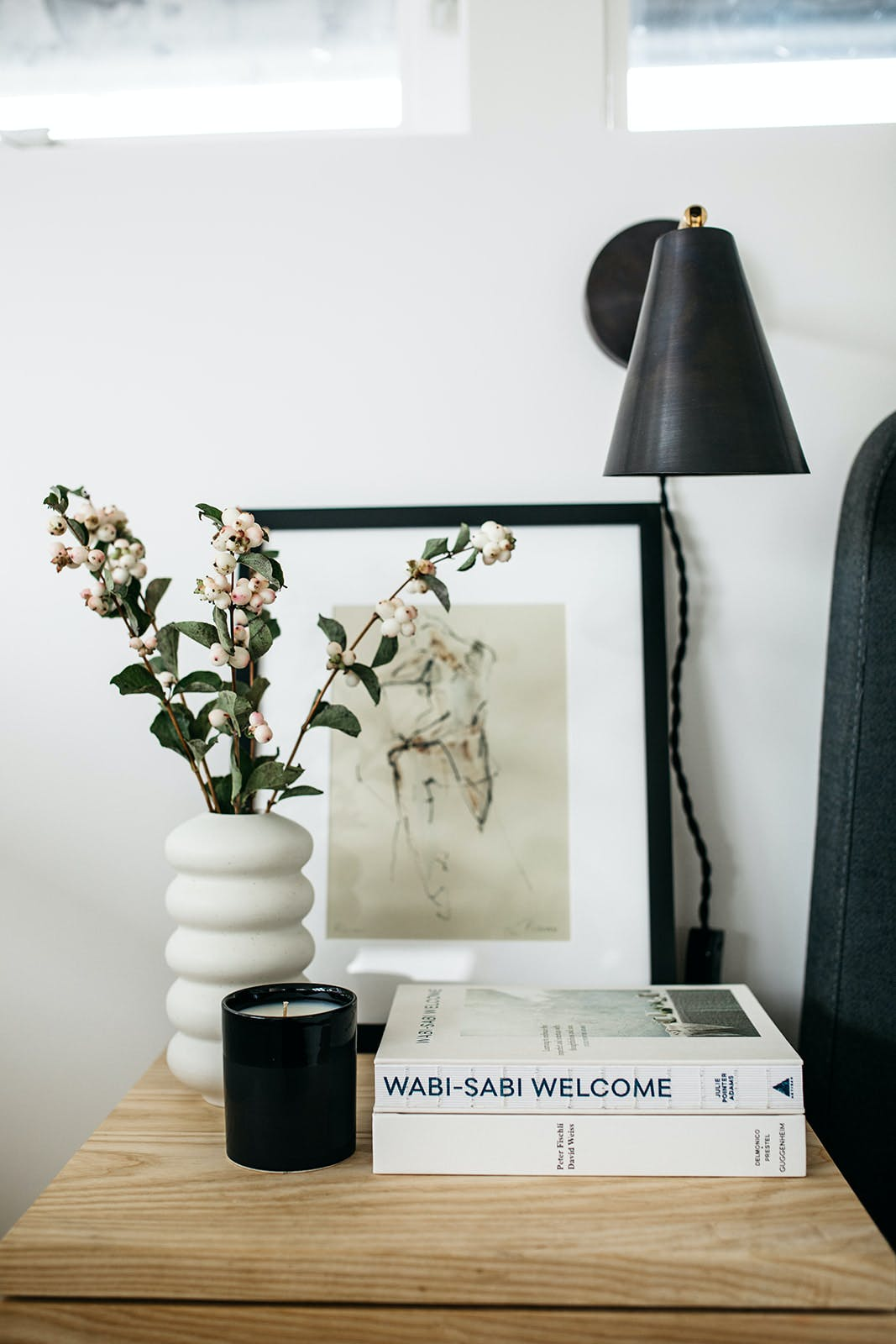 Table with plant, book, painting and lamp