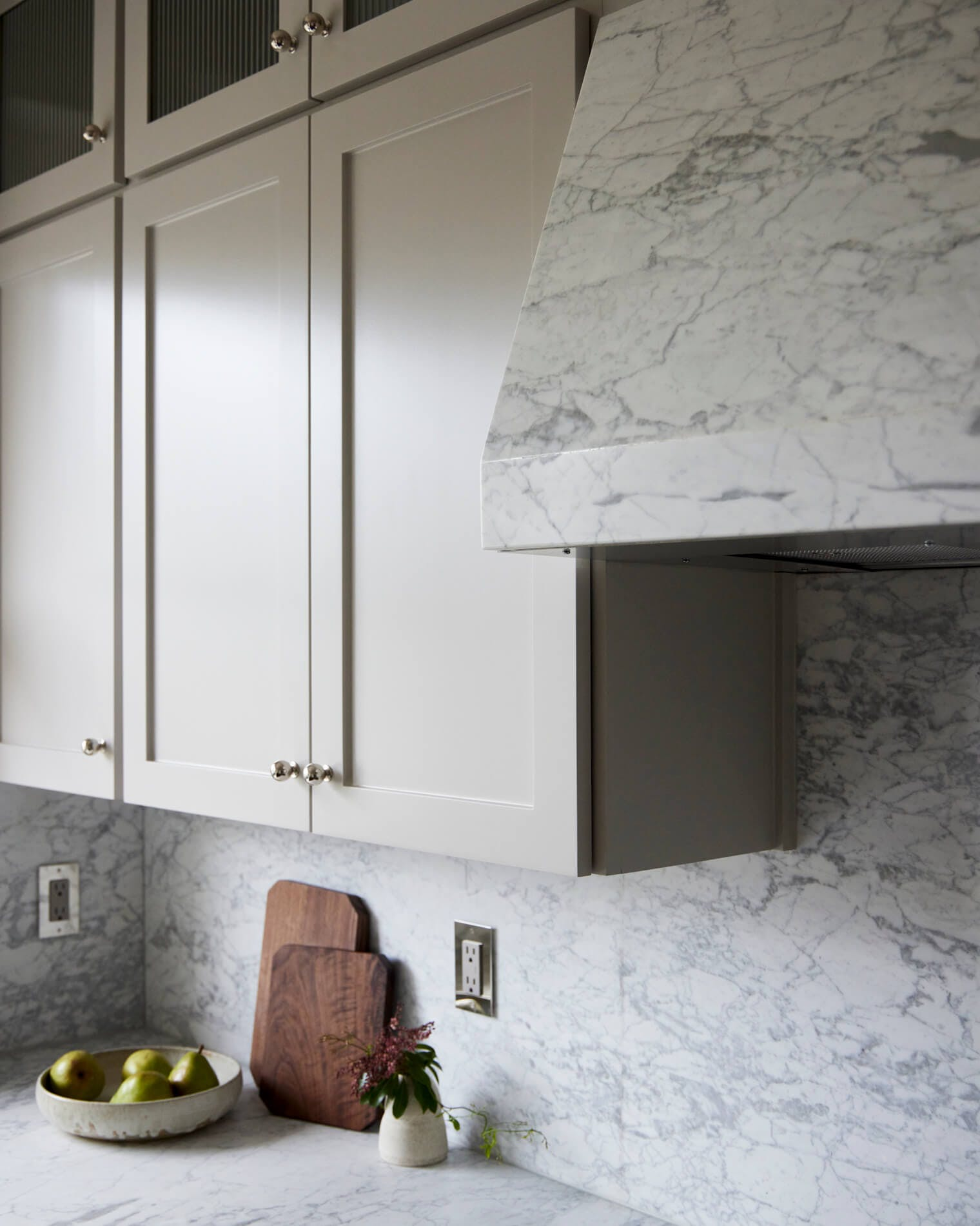 Kitchen cupboards and marble hood cover