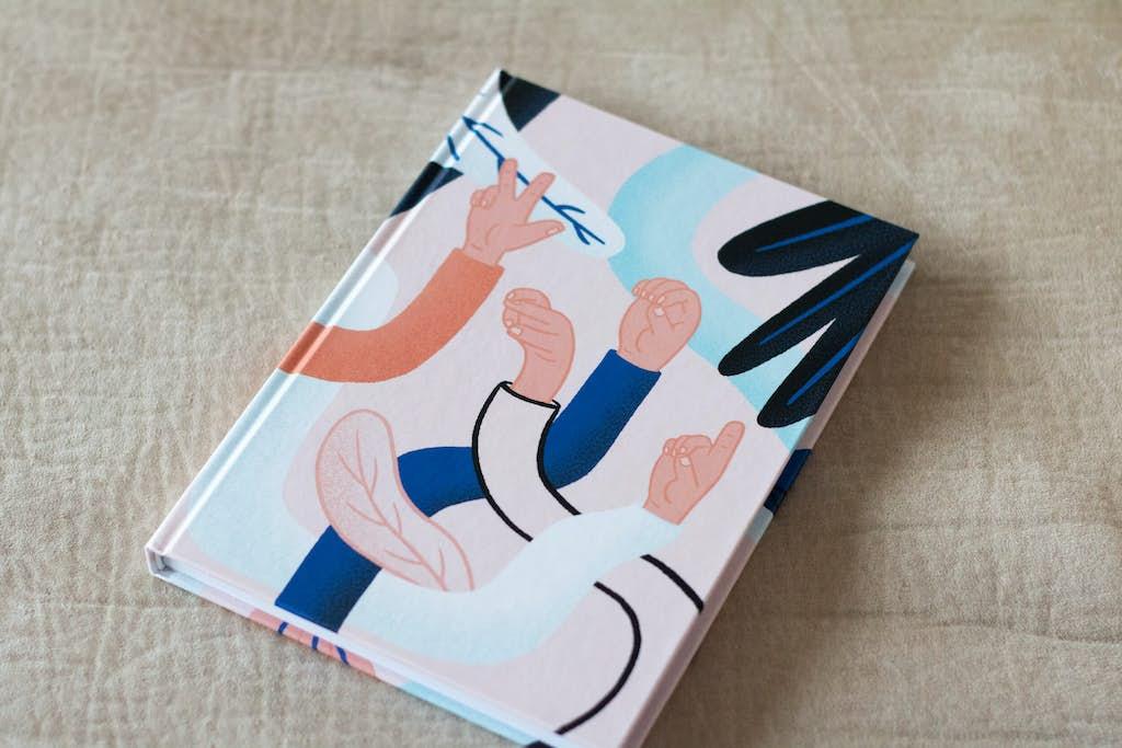 Voorkant relatiegeschenk notitieboekje wordlenig