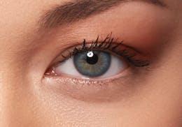 Dark brown eyes after wearing SWATI Sapphire - Sky Blue Coloured lenses