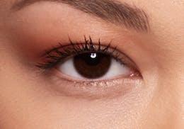 Dark brown eyes before wearing SWATI Sapphire - Sky Blue Coloured lenses