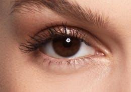 Brown eyes before wearing SWATI Pearl - Grey Coloured lenses