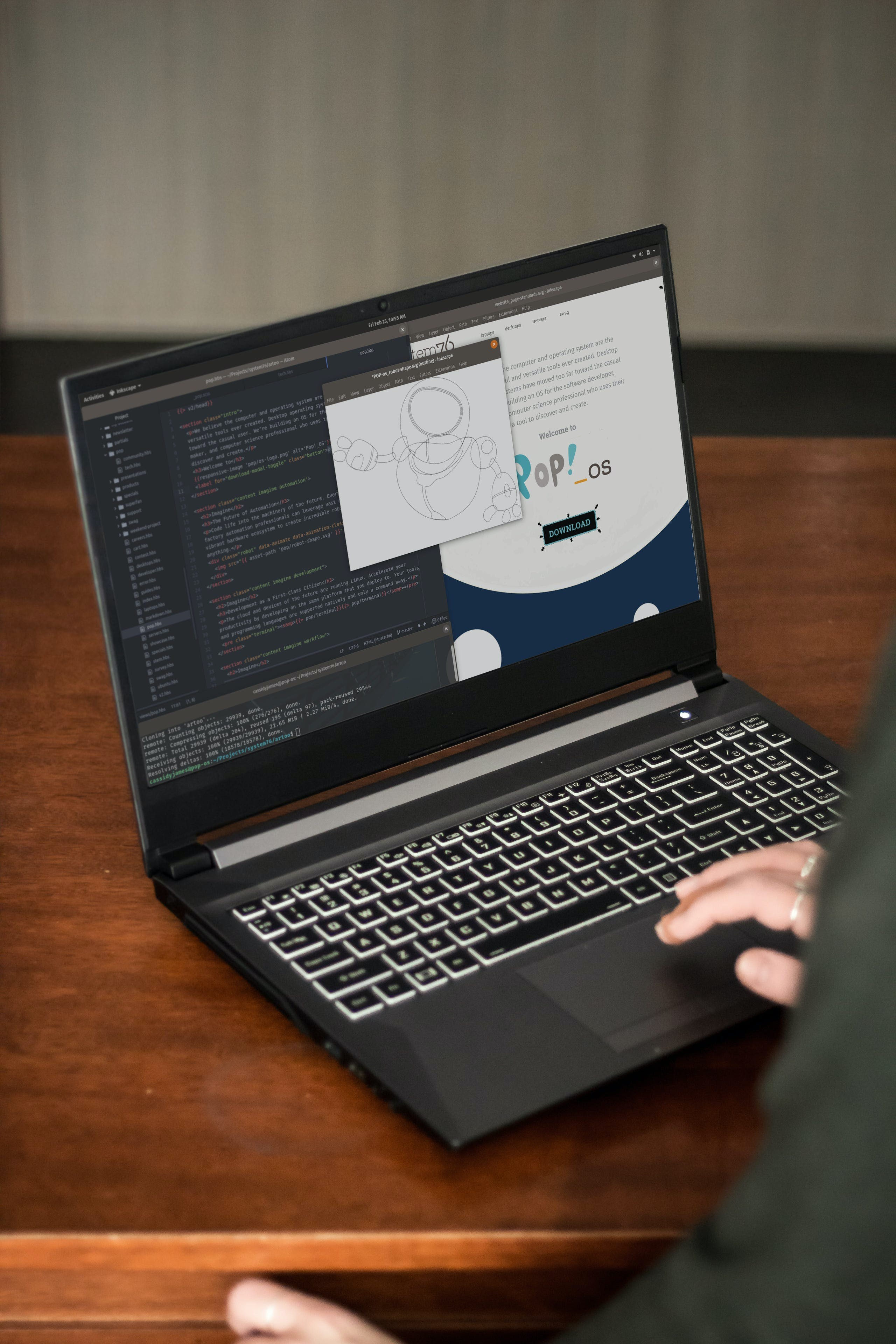 A person working on a vector drawing of a robot in Inkscape.