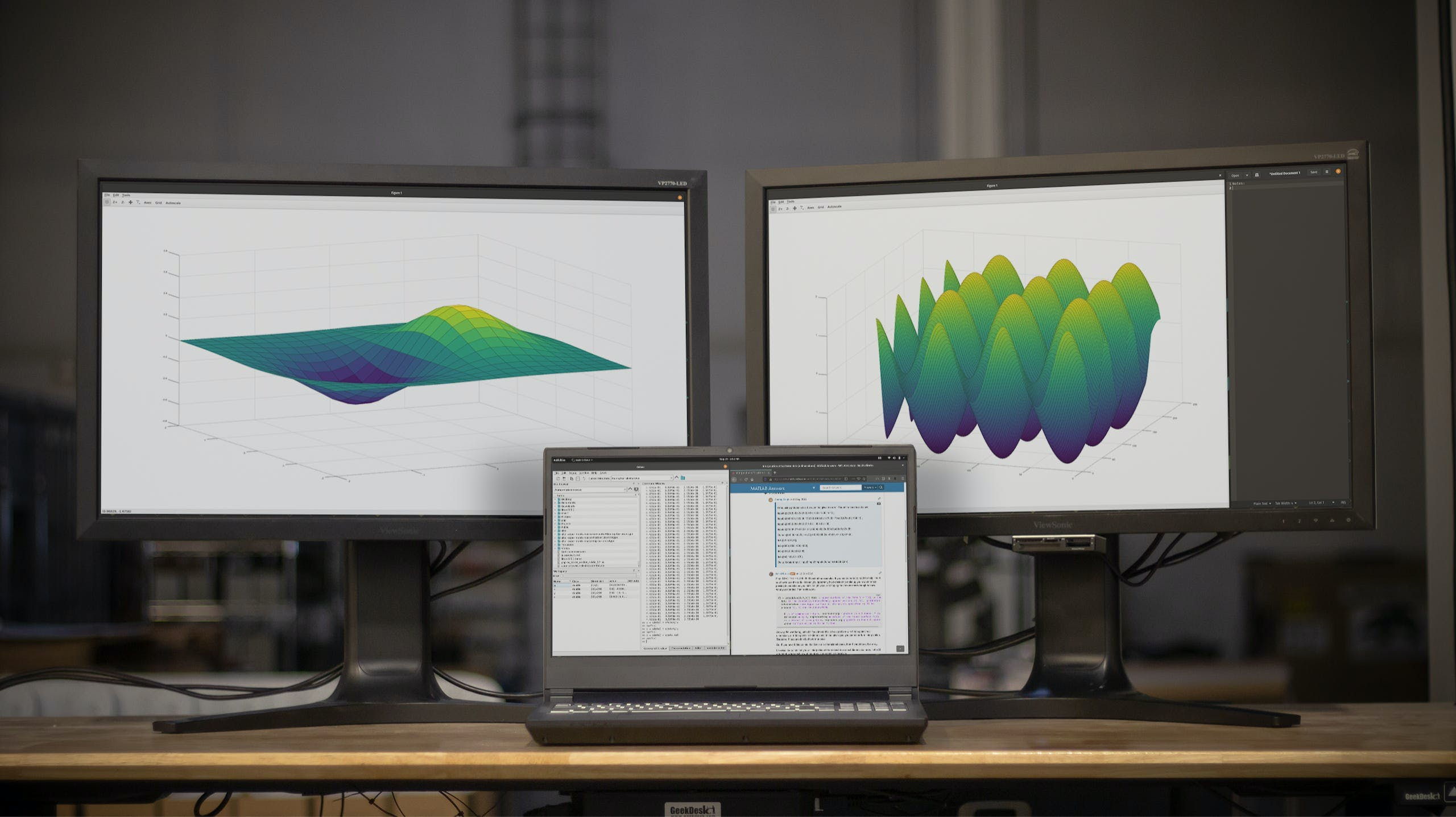 The Serval WS running and graphing scientific computations across three displays.