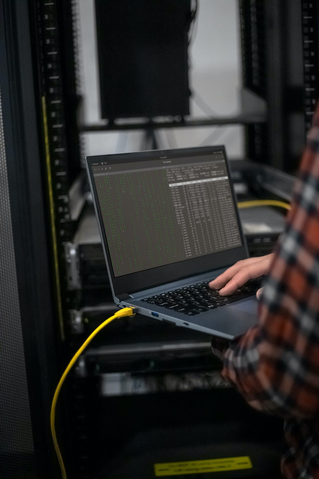 A person using the Galago Pro to connect to a server via Ethernet.