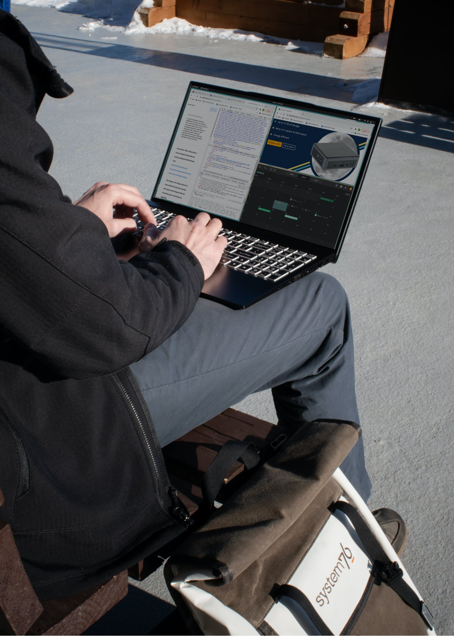 A person using the Darter Pro laptop on their lap, with a System76 backpack by their side.