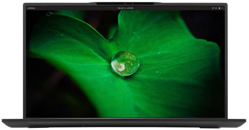 The Darter Pro laptop featuring a vivid wallpaper of dew on a leaf.