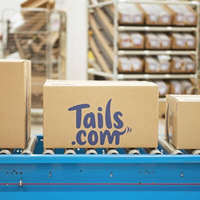 a tails.com box at the factory
