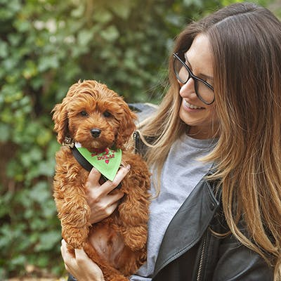 Lucy holding her Cavapoo puppy, Dylan