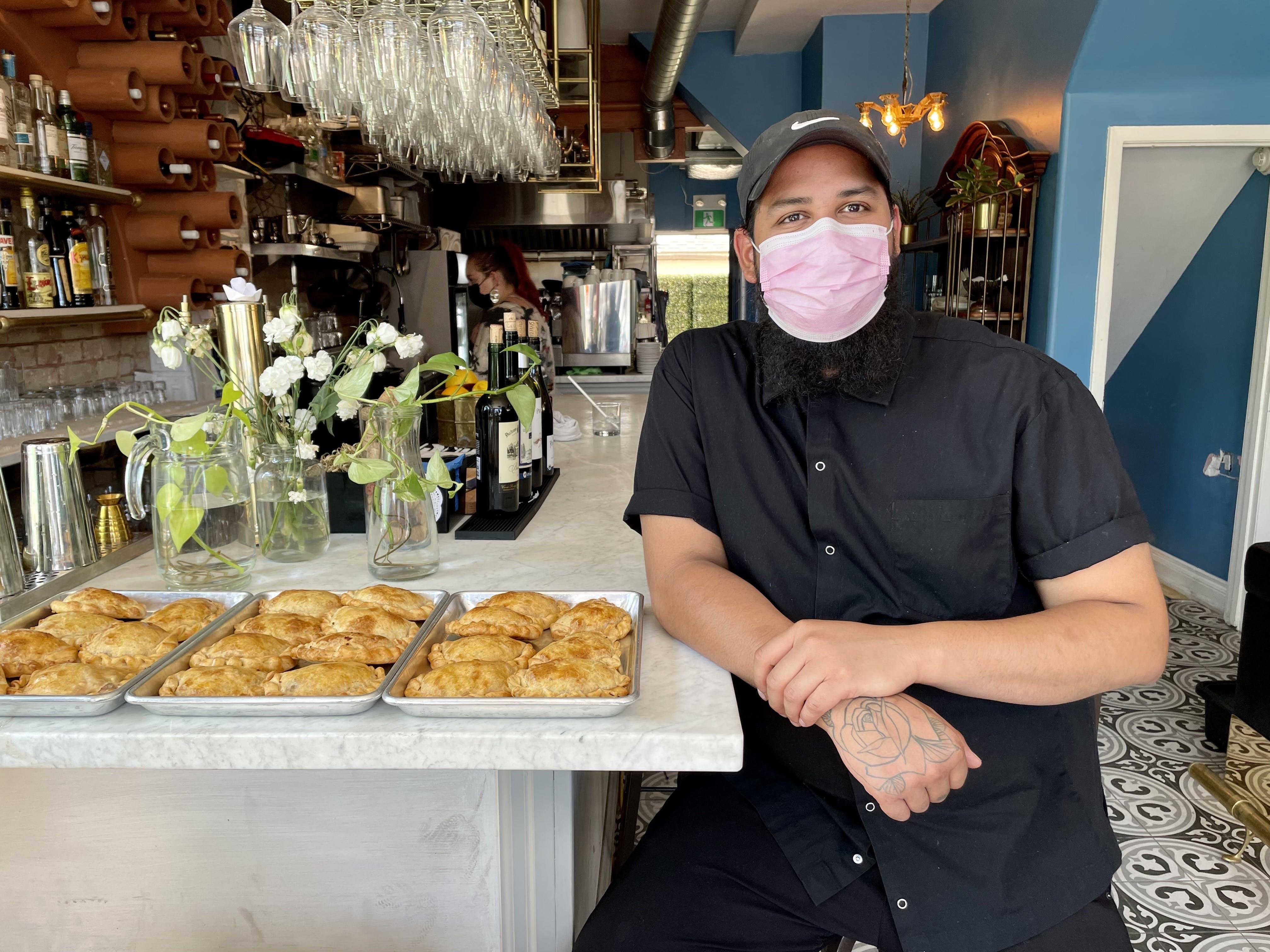 Chef André Burgos and freshly-rolled empanadas