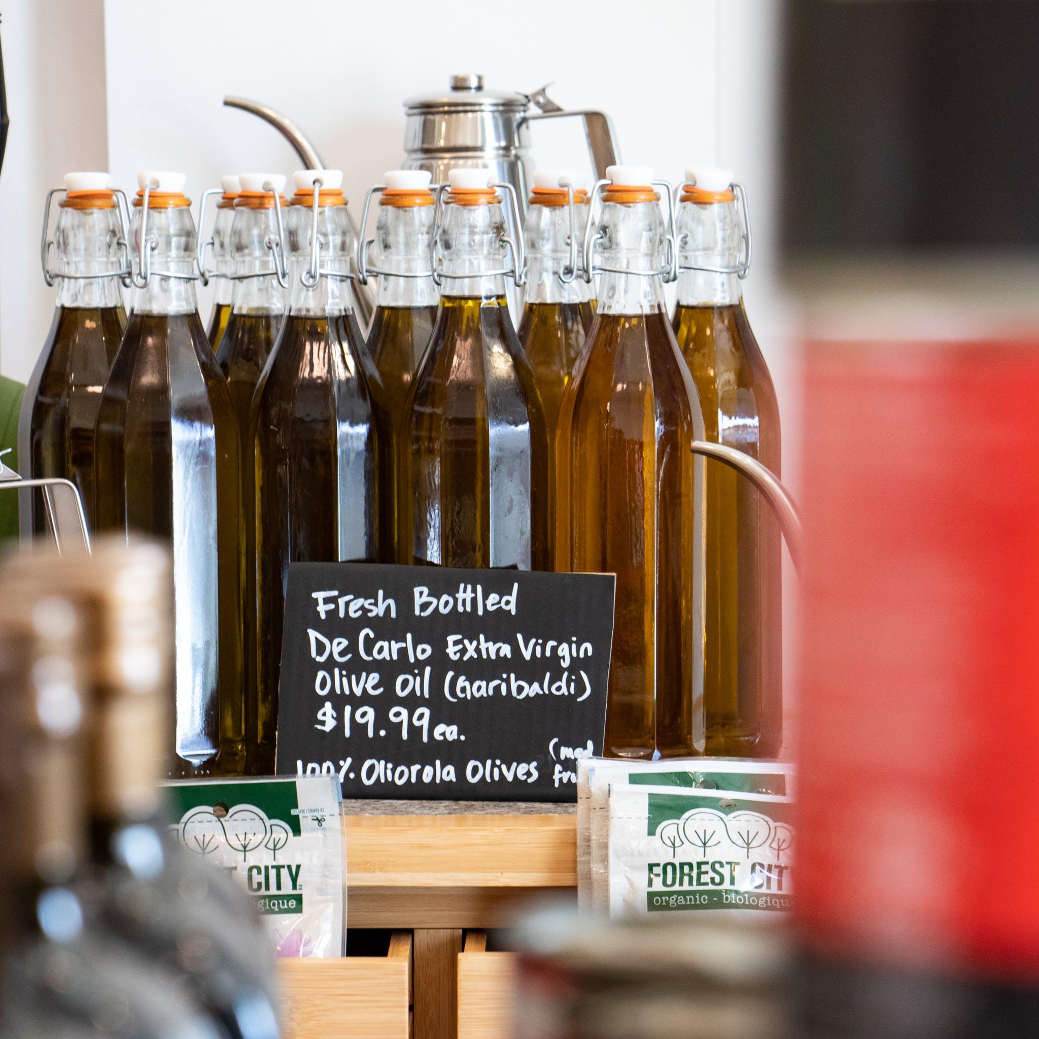Fresh bottled olive oil from La Spesa Food Market. Image by: @paothebao