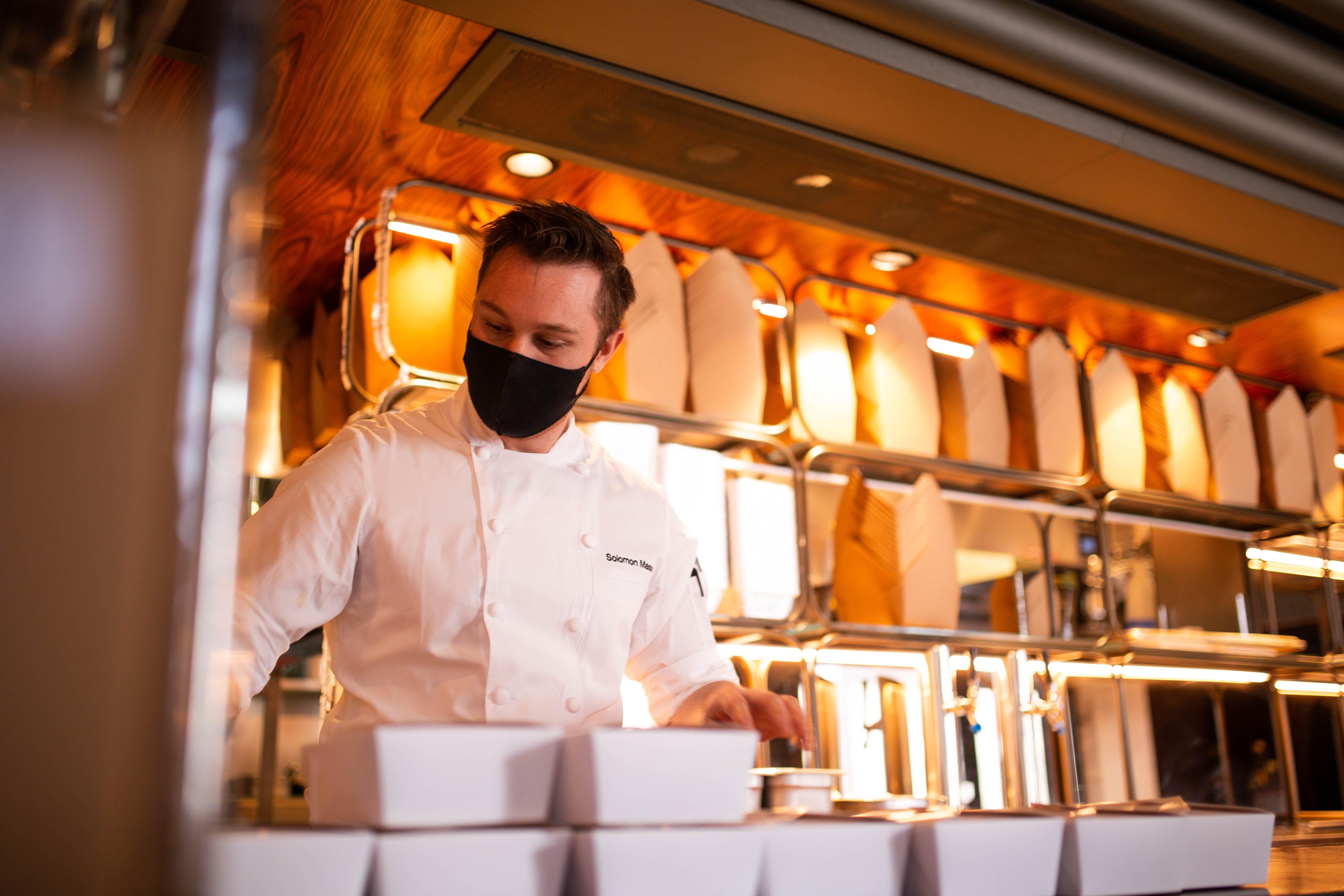 Solomon Mason prepares takeout meals at Aloette in Toronto.